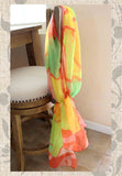 Ambrosia Scarves by The Art of Wendy Christine feature tangerine orange wavy outlines around pinks greens and yellows.  Bright beautiful colorful scarf to purchase, buy, find.  Raspberry Lane Crafts