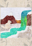 Raspberry Lane Crafts Arctic Fox's Frozen Waterfall Quilt Block Pattern by Wendy Christine shows a white fox staring at a frozen green-aqua waterfall & stream with snow-capped mountains in the background.  Part of the Ice Habitats Quilt Collection