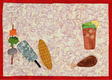 Barbecue Placemat features a glass of iced tea, chicken leg, corn on the cob, spatula and kabob with pepper, broccoli and mushroom.  Design by Wendy Christine at Raspberry Lane Crafts.  Part of the Dinner-On-Us Placemats quilted pattern.