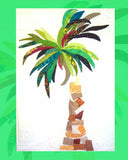 Raspberry Lane Crafts Banana Palm appliqué includes banana-shaped green leaves palm with a tree trunk of brown and gold squares and triangles.