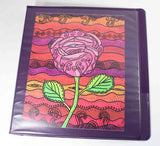 Mission Rose art print in 3-ring purple binder is of a pink rose with green leaves on sunset colored background in reds, purples and oranges.  From the Art of Wendy Christine at Raspberry Lane Crafts.  Purchase, buy, sale, find.  Thank You!