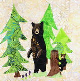 Black Bear Forest quilt block pattern picture of completed block features a standing black bear and cub on tree stump with three green trees and purple lupine flowers.  Raspberry Lane Crafts. Buy Purchase for Sale
