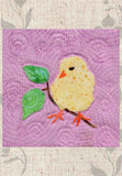 Chick six inch quilt block features an adorable yellow chick with orange beak and feet, black eye near a brown branch with two green leaves.  Included in Blooming Spring quilt pattern wallhanging at Raspberry Lane Crafts.  Designed by Wendy Christine. New March 2018