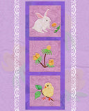 Blooming Spring wallhanging for Easter features a white rabbit sniffing a dandelion, yellow and green aconite flowers, a yellow chick with leaves and a branch.  Pattern designed by Wendy Christine and available at Raspberry Lane Crafts.  New quilt pattern March 2018.