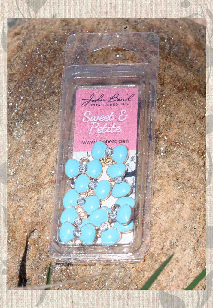 Buy Light Blue Bow Charms with crystal middles at Raspberry Lane Crafts Sweet and Petite John Bead