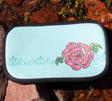 Blue Stone Mint Cosmetics Bag features a pink rose on mint green.  Made of neoprene.  For sale at Raspberry Lane Crafts