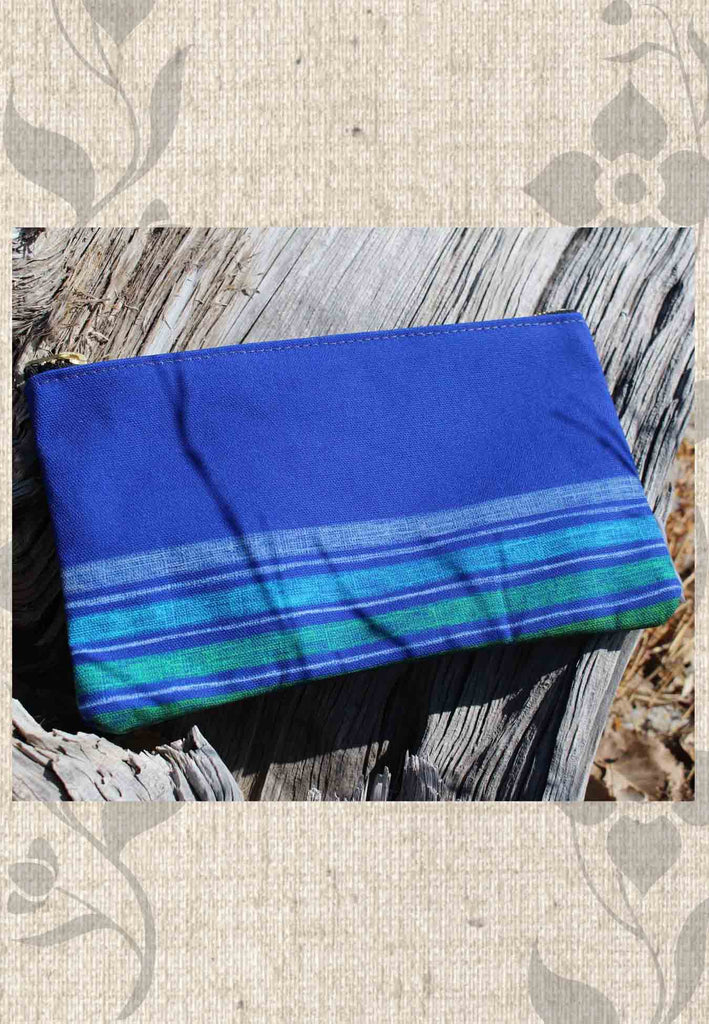 Blue Stripe Accessory Pouches feature four colored stripes on blue zipper bag in multiple sizes.  For sale from Raspberry Lane Crafts