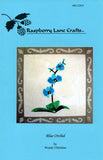 Front cover of Blue Orchid quilt block pattern available for purchase at Raspberry Lane Crafts printed on blue paper with photo of completed block.  Design by Wendy Christine. May 2018 New Pattern.