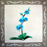 Blue Orchid 15 inch quilt block pattern completed photo features a magnificent three flowered aqua blue orchid with buds on a dark green stem with vivid emerald green leaves and a floral filigree border on taupe gray.  Raspberry Lane Crafts. Buy or purchase pattern.