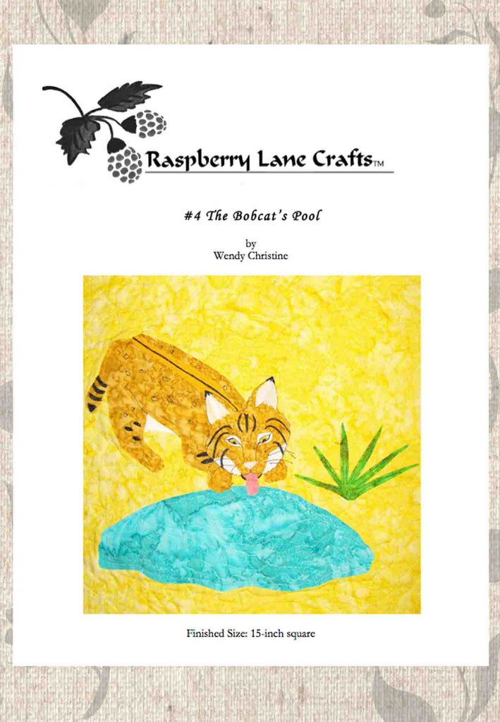 """The Bobcat's Pool"" quilt block pattern digital download front page features an orange bobcat lapping aqua water from the ground near a green yucca. Buy at Raspberry Lane Crafts."