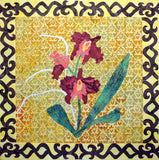 Scarlet, coral and gold petals of the Burgundy Bliss orchid adorn this quilt block with a filigree border at Raspberry Lane Crafts