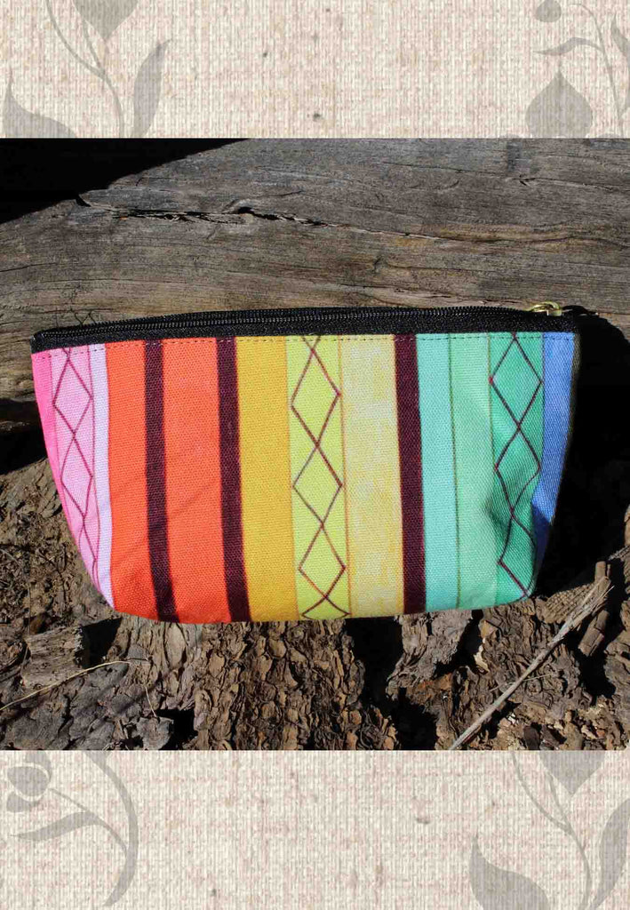 Cabana Accessory Pouches are striped in rainbow colors with zippers for sale at Raspberry Lane Crafts.
