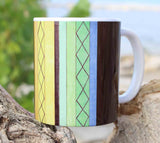 Cabana Mug from The Art of Wendy Christine Colorful Stripes Green Yellow Orange Pink Blue with Brown for Sale at Raspberry Lane Crafts