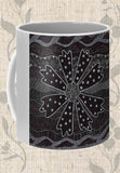 Buy Black Mug with Flowers - Charcoal Daisy Coffee Mug by Wendy Christine sold at Raspberry Lane Crafts features a black daisy design on white mug.