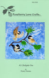 Raspberry Lane Crafts Chickadee Tree Quilt Block by Wendy Christine contains three chickadees on a Ponderoda pine branch (one in flight) - tans, black & white on a blue background.