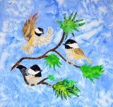 Chickadee tree quilt block pattern features two alighted and one flying chickadee on a green pine branch