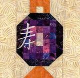 Chinese Lantern Longevity quilt block pattern features a violet lantern with golden handle and base.  Designed by Wendy Christine at Raspberry Lane Crafts.
