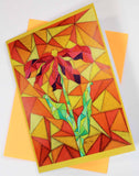 Clementine Greeting Card with Orange Envelope features a Stained Glass style red flower with green leaves and orange and yellow background.  From the Art of Wendy Christine.  Available to purchase at Raspberry Lane Crafts.
