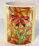 Clementine Mug features a stained glass looking bright red flower with green leaves and stem on orange and yellow with yellow wrap-around color.  For sale at Raspberry Lane Crafts.