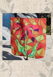 Clementine Tote Bags feature Red Flower with Orange Stained Glass Looking Design for sale at Raspberry Lane Crafts