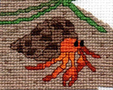 An orange hermit crab cross stitch pattern for sale