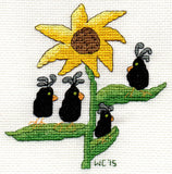 Crowflower features a brown-centered golden sunflower with four cute black crows along the green leaves.  At Raspberry Lane Crafts.
