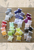 New DMC six-stranded embroidery floss numbers 1 through 35 wound on floss bobbins photo.