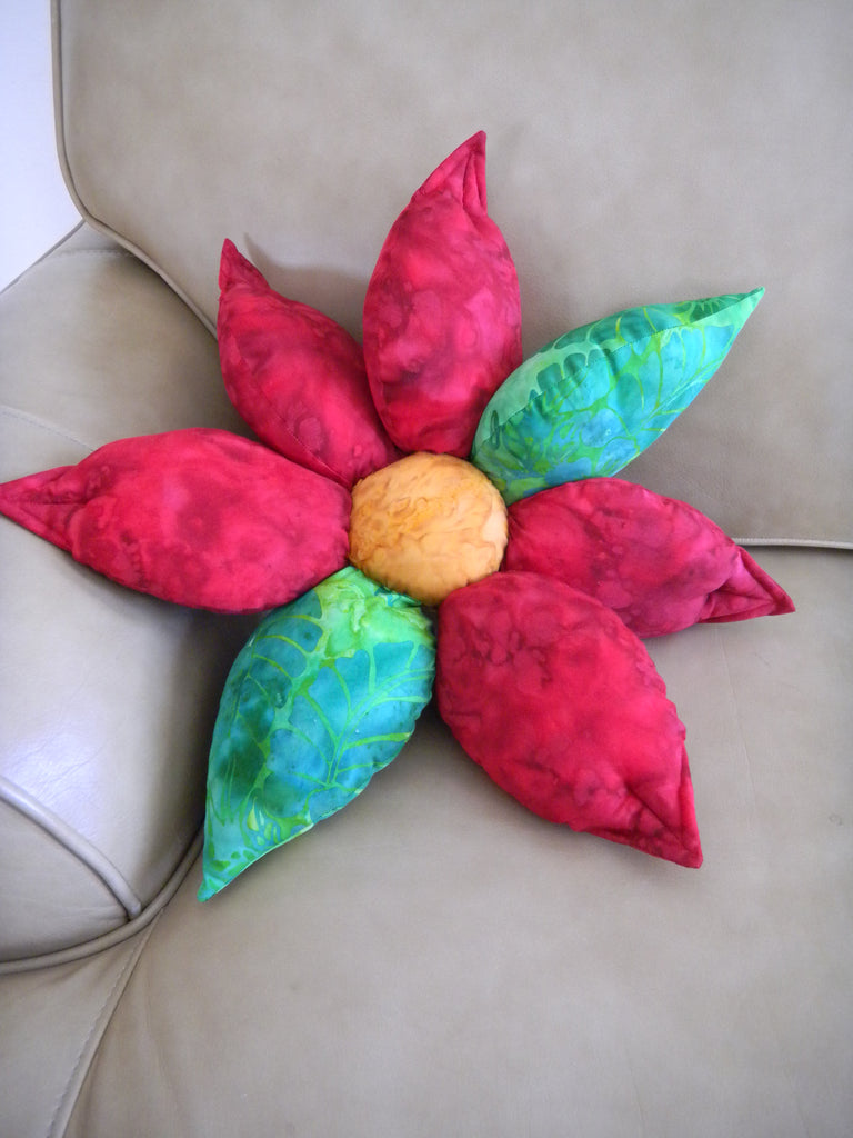 Poinsettia Pillow Christmas Holiday Pattern finished pillow photo features five red stuffed petals and two green stuffed leaves with golden stuffed center.  Beautiful pillow for holidays.  Raspberry Lane Crafts. Buy Purchase for Sale.