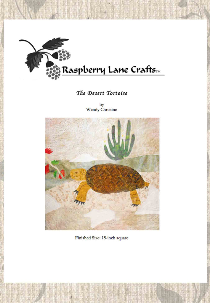 Desert Tortoise quilt block pattern digital download front page pictures the completed block with tortoise eating fairy duster blooms with senita cactus.  Purchase at Raspberry Lane Crafts.