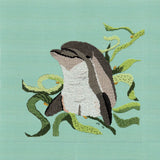 Dolphin with Kelp completed cross stitch picture features a gray dolphin with green flowing kelp on a blue background.  For Sale, Buy, Purchase Find at Raspberry Lane Crafts.  Pattern for Sale.
