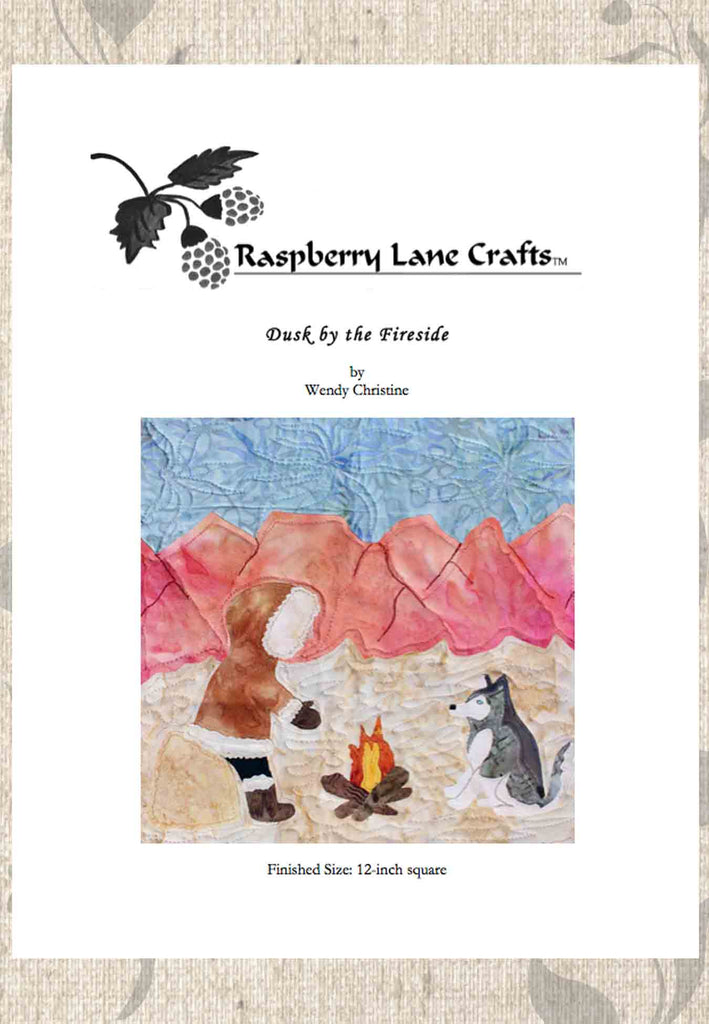 Dusk by the Fireside quilt block pattern digital download features a Siberian Husky and person in fur coat warming by a camp fire with mountains in the background.  Sold by Raspberry Lane Crafts.