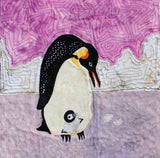 """Emperor Penguins"" features lavender ice on which the chick sits atop the adult penguins feet. Quilt block pattern by Wendy Christine.  Part of the Ice Habitats Quilt Block Collection"