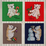 Four Jolly Bears cross stitch pattern depicts a tan teddy bear with a candy cane on green fabric, fir branch on red fabric, hanging colorful ornaments on brown fabric, and with a blue snowman on navy fabric.  Pattern by Wendy Christine