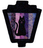Black cat silhouette on purple strips gaslight lantern sewing quilt pattern for Halloween buy at Raspberry Lane Crafts.