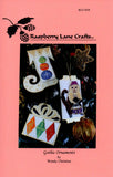 Gothic Ornaments cross stitch pattern cover page features the Raspberry Lane Crafts logo and a photo of the completed ornaments: Monkey Drummer, Crystal Balls Stocking, and Sparkling Diamonds Present.  Designed by Wendy Christine at www.raspberrylanecrafts.com
