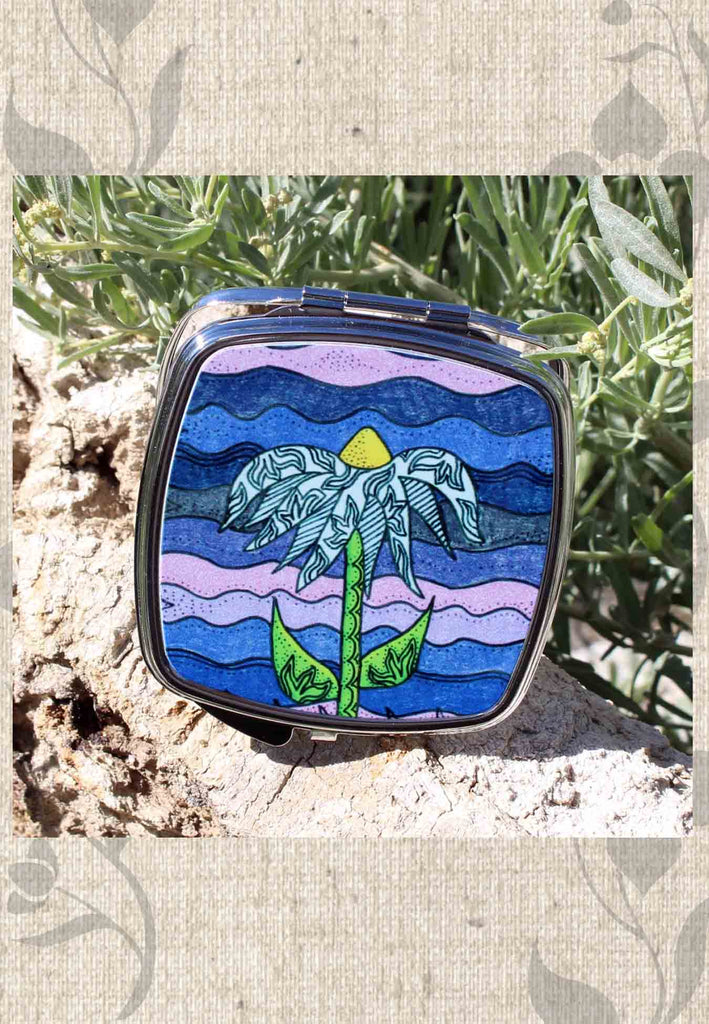 Buy purple compact mirrors at Raspberry Lane Crafts Grapesugar features a blue flower on purple.  The Art of Wendy Christine