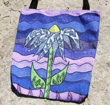 Grapesugar Tote Bags have a Southwest Light Blue Flower on Shades of Purple for Sale at Raspberry Lane Crafts.  Three sizes available.  Great Prices!