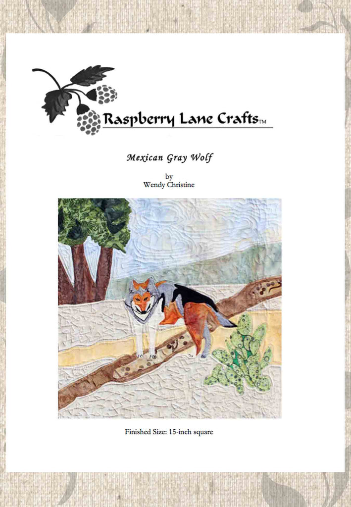 Mexican Gray Wolf quilt block pattern download front cover pictured the finished block with a rust, gray, black and white colored wolf near a bush.  Buy at Raspberry Lane Crafts.