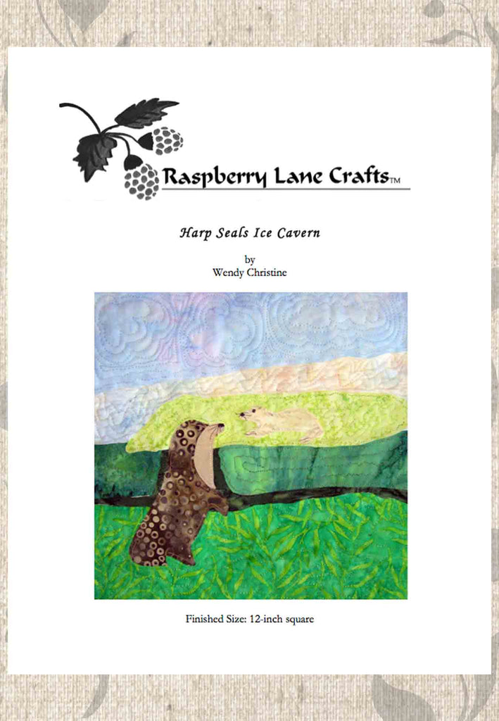 Harp seals ice cavern quilt block pattern digital download front cover shows a brown seal with white baby pup in ice cave with green ice and water.  From Raspberry Lane Crafts, buy, purchase.  Designed by Wendy Christine.