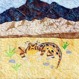 Raspberry Lane Crafts The Horned Lizard features a horny toad near grass and rocks in the Great Sand Dunes.  Part of the Desert Habitats Quilt Collection by Wendy Christine