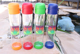 The Ocean to Ozone Show merchandise water bottles for sale at Raspberry Lane Crafts.  A tall clear water bottle with the yucca logo and base and lid in four colors orange, red, green and blue.