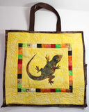 Yellow with brown trim bag with a lizard in center surrounded by colored squares in Lizard Shopping Bag by Wendy Christine at Raspberry Lane Crafts