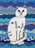 Ice Cat cross stitch pattern depicts a white cat with blue eyes and pink nose against a decorated wavy blue background with red highlights.  Based on The Art of Wendy Christine's Ice Cat.  Purchase at Raspberry Lane Crafts.
