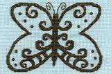 Lace butterfly cross stitch pattern of brown gray beautiful shape on pastel blue fabric available in the Lace in Blue pattern at Raspberry Lane Crafts.  Designed by Wendy Christine.