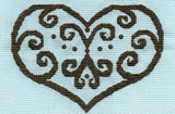 Lace outline of heart stitched in flourishes and dots against a pastel blue AIDA cross stitch fabric.