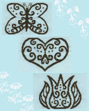 Antique lacy outlines in brown gray on a light blue fabric in Lace in Blue cross stitch pattern featuring the shapes butterfly, heart and tulip.  Only at Raspberry Lane Crafts. Designed by Wendy Christine.  Digital or paper pattern.