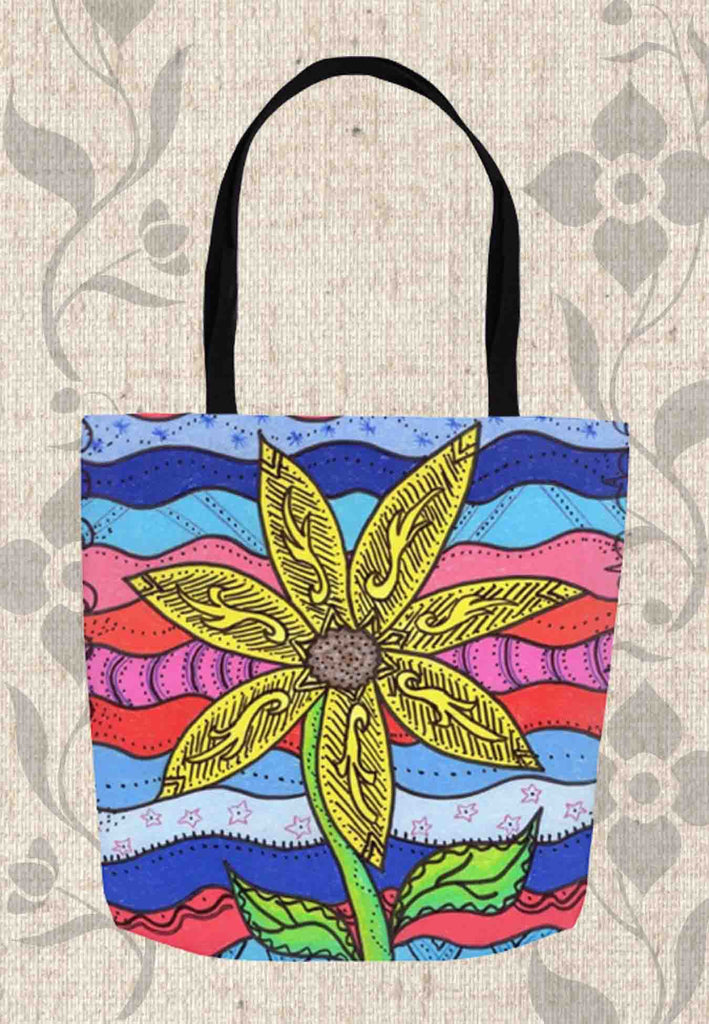 Liberty Tote Bags feature a yellow flower on white red and blue from a Southwest art print by Wendy Christine.  For Sale at Raspberry Lane Crafts.