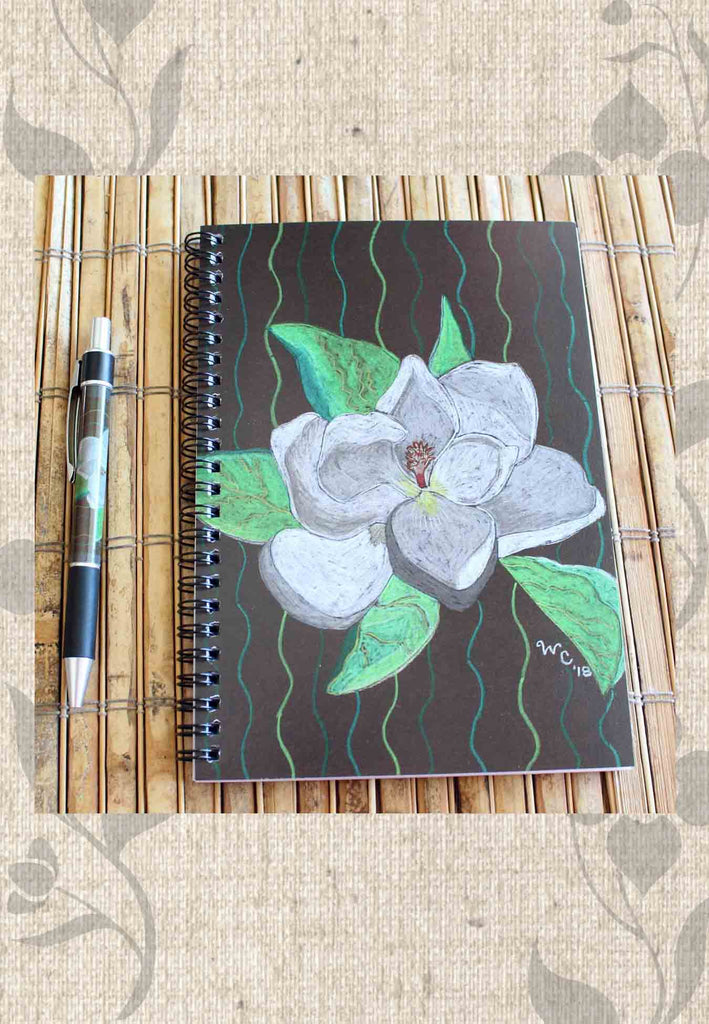 Flower Spiral Notebook and Matching Pen Gift Set for Sale features a white flower with green petals on brown.  Artwork by Wendy Christine.  Find Buy Purchase at Raspberry Lane Crafts