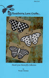 Mardi Gras Butterfly Collection cross stitch patterns include three black and white butterflies: a checkered, spotted and striped butterfly by Wendy Christine at Raspberry Lane Crafts.
