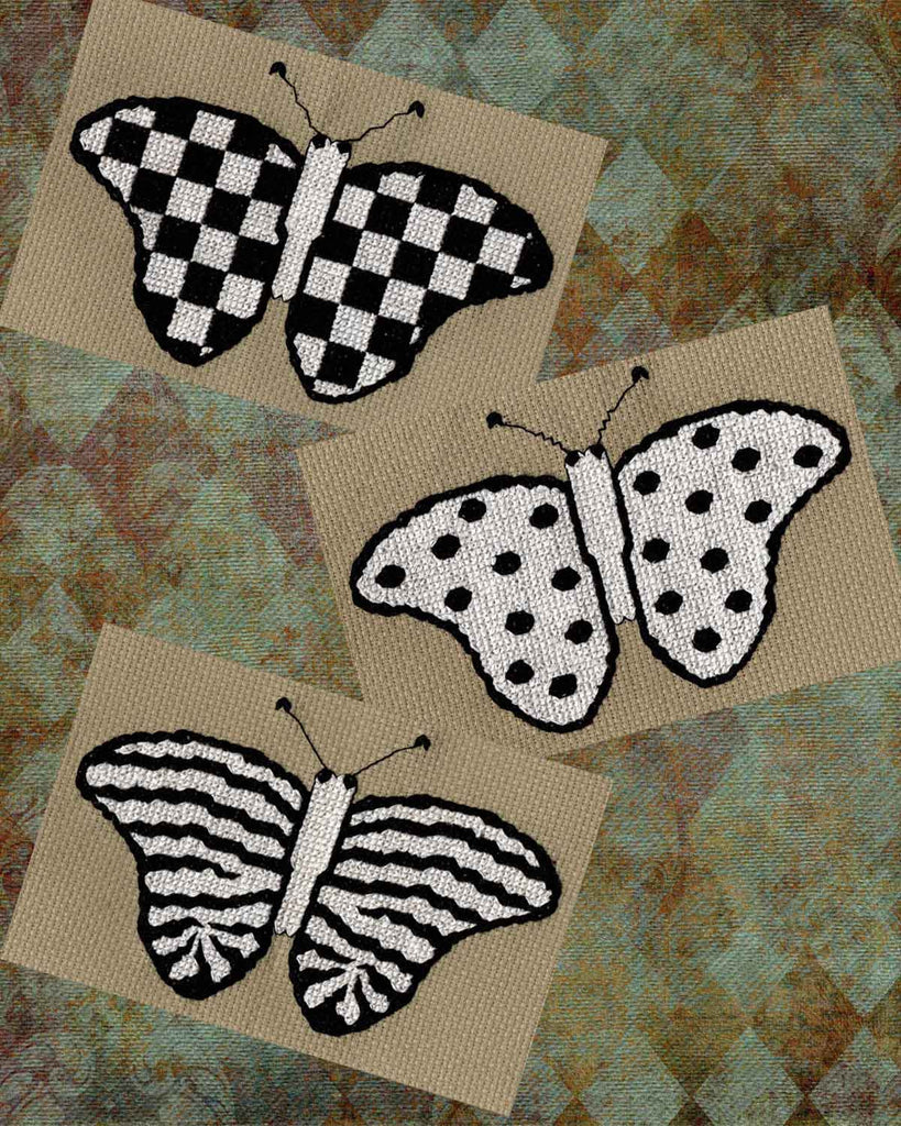 Mardi Gras Butterfly Collection cross stitch pattern picture of three butterflies on harlequin backdrop: a spotted, striped and checkered butterfly in black and white by Wendy Christine at Raspberry Lane Crafts.